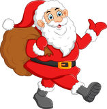 Santa waving and holding sack Royalty Free Stock Image
