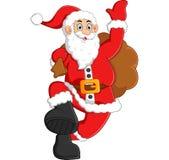 Santa waving and holding sack Royalty Free Stock Image