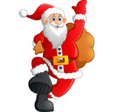 Santa waving and holding sack Stock Images