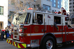 Santa Waving From Ladder Fire Truck Royalty Free Stock Image