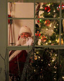 Santa Waving out of a Window. Royalty Free Stock Photography