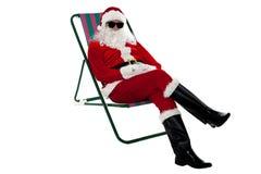 Santa wearing shades and striking stylish pose Royalty Free Stock Images