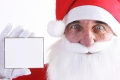 Santa with a white card Stock Photo