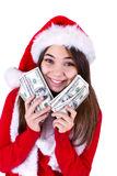 Santa Will Bring More Money. Teenager girl with Santas hat and holding her paycheck, all one hundred dollar banknotes. Isolated on white background Stock Photo