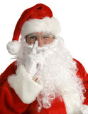 Santa Winks. Santa laying his finger aside of his nose and giving a wink.  Isolated on white Stock Photography