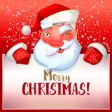 Santa winks and greetings Royalty Free Stock Image