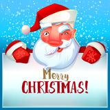 Santa winks and Merry Christmas Royalty Free Stock Photos