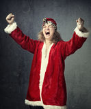 Santa is winner. Screaming happy man in Santa Claus costume on a grungy background Royalty Free Stock Photography
