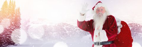 Santa with Winter landscape in sack Stock Photo
