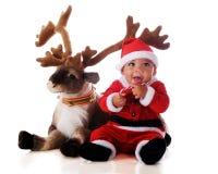 Santa With Reindeer Stock Photos