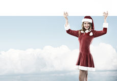 Santa woman with banner Stock Image