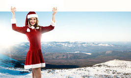 Santa woman with banner Stock Photography