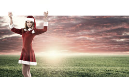 Santa woman with banner Stock Images