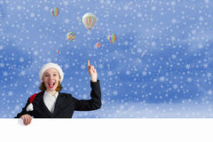 Santa woman with banner Royalty Free Stock Image
