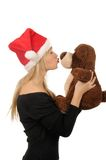 Santa woman with bear isolated on white Royalty Free Stock Images
