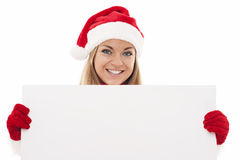 Santa woman with blank board Royalty Free Stock Photos