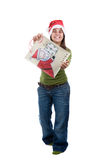 Santa woman celebrating christmas with present bag Stock Photo