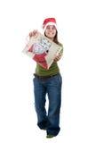 Santa woman celebrating christmas with present bag Stock Photo