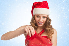 Santa woman with Christmas gift Stock Images