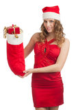 Santa woman with Christmas gifts Stock Photo
