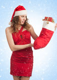Santa woman with Christmas gifts Royalty Free Stock Image