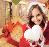 Santa woman christmas hearth smiling Stock Image