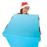 Santa woman in christmas holding big present box Stock Photos