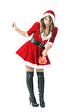 Santa woman cleaning with pink feather duster Stock Photos