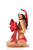 Santa woman covering her body by ribbon Stock Photo