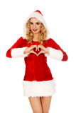 Santa woman doing a heart with her hand Royalty Free Stock Photos