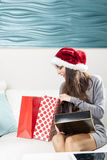 Santa woman doing online shopping Stock Photography