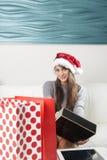 Santa woman doing online shopping stock photography