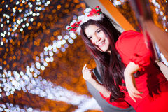 Santa woman dressing. Stock Photo