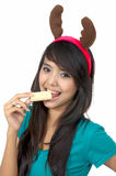 Santa Woman Eat Wafer Royalty Free Stock Images