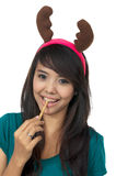 Santa Woman Eat Wafer Stock Photo