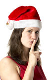 Santa woman with finger at mouth Stock Photo