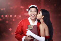 Santa woman give kiss to her lover Stock Images
