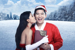 Santa woman give kiss to her lover Royalty Free Stock Photo