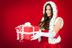 Santa woman giving a present Royalty Free Stock Image