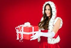 Santa woman giving a present Royalty Free Stock Image