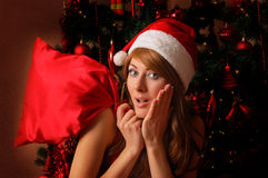 Santa woman helper with Christmas bag royalty free stock images