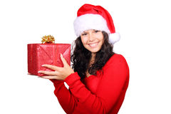 Santa woman holding christmas gift isolated. Smiling Santa girl holding a red christmas present isolated on white Stock Images