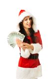 Santa woman holding a clip of polish money Stock Photo