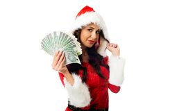 Santa woman holding a clip of polish money Stock Photography