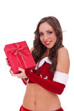 Santa woman holding a gift Royalty Free Stock Images