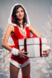 Santa woman holding a gift box Royalty Free Stock Photo