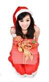 Santa woman  holding a gift box Stock Photos