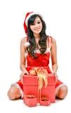 Santa woman  holding a gift box Royalty Free Stock Image