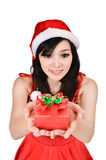Santa woman  holding a gift box Royalty Free Stock Images