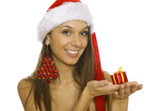 Santa woman holding gift wearing Santa hat Royalty Free Stock Photos